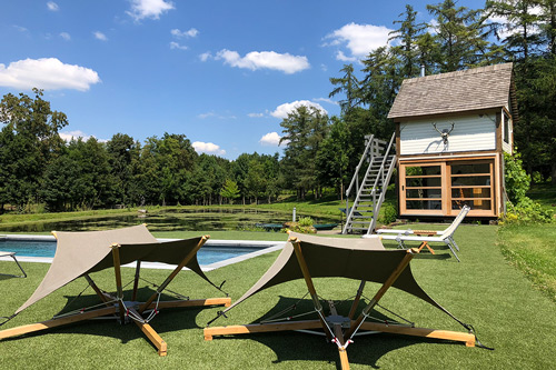 lodge-zwembad-zon-stoel